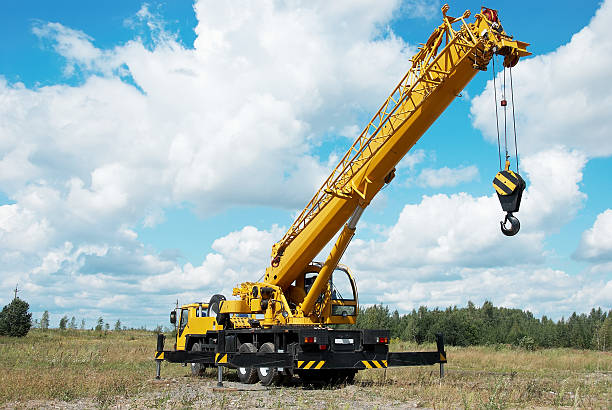 a shot of a mobile crane in an open field