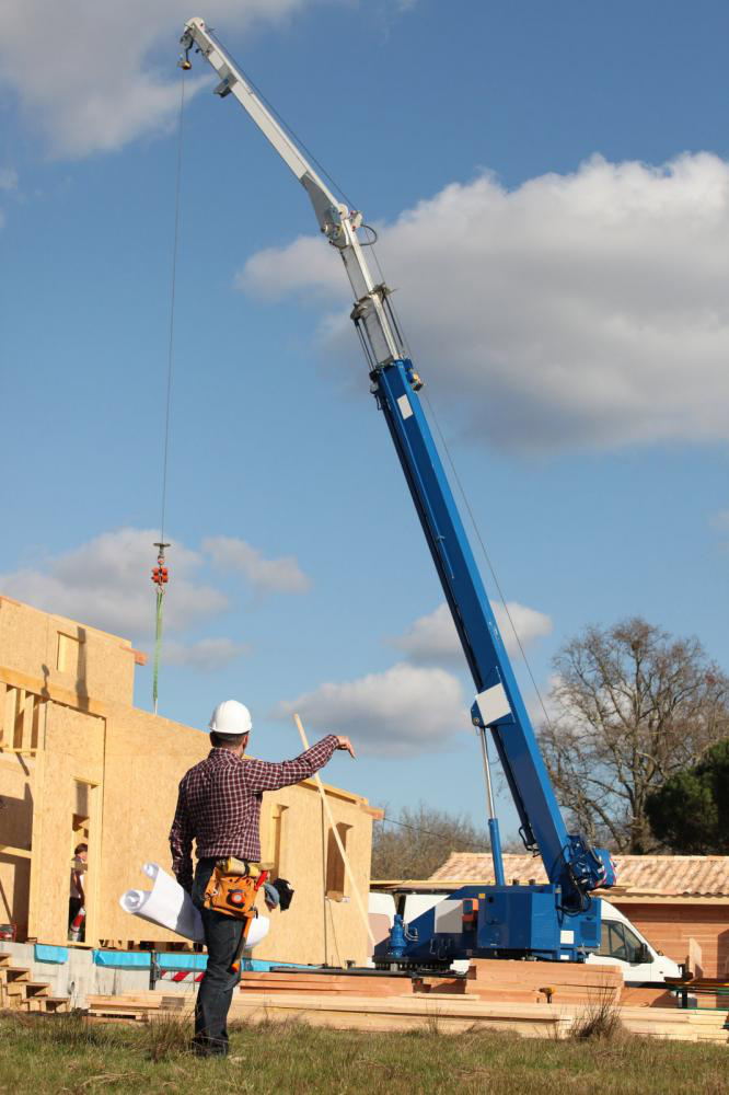 A foreman using a load chart to give instructions to a crane operator.