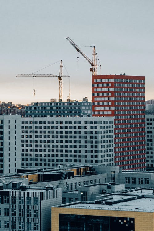 a crane with buildings