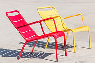 Empty red and yellow metal outdoor chair