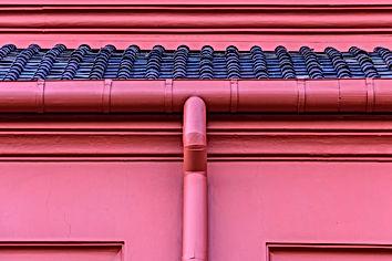 Metal roof gutter in red color..jpg