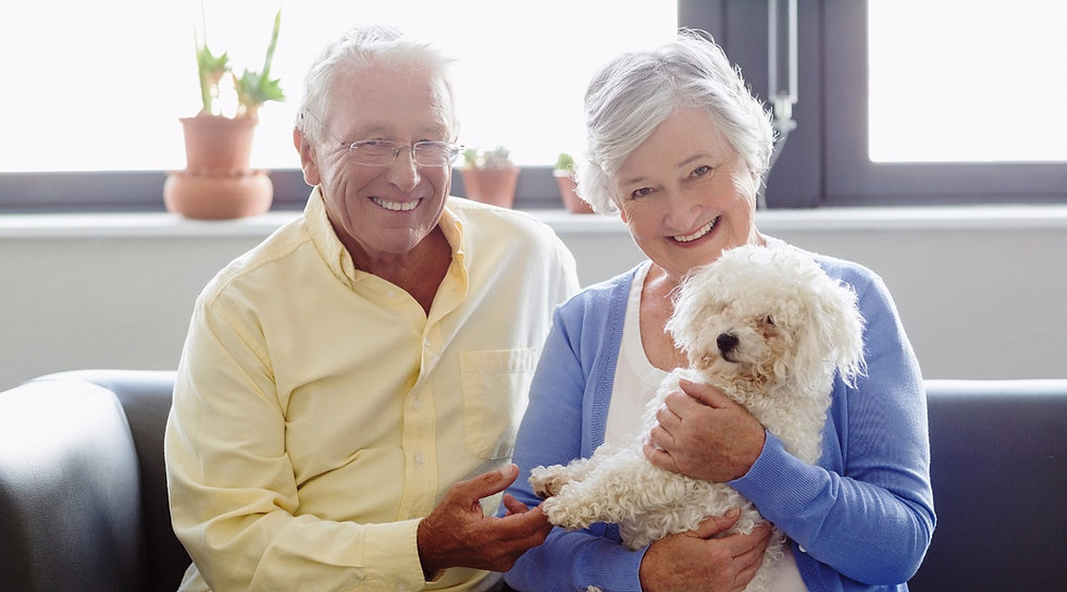 Elderly Couple Holding A Dog