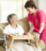 Home Health Aie Feeds Elderly Woman