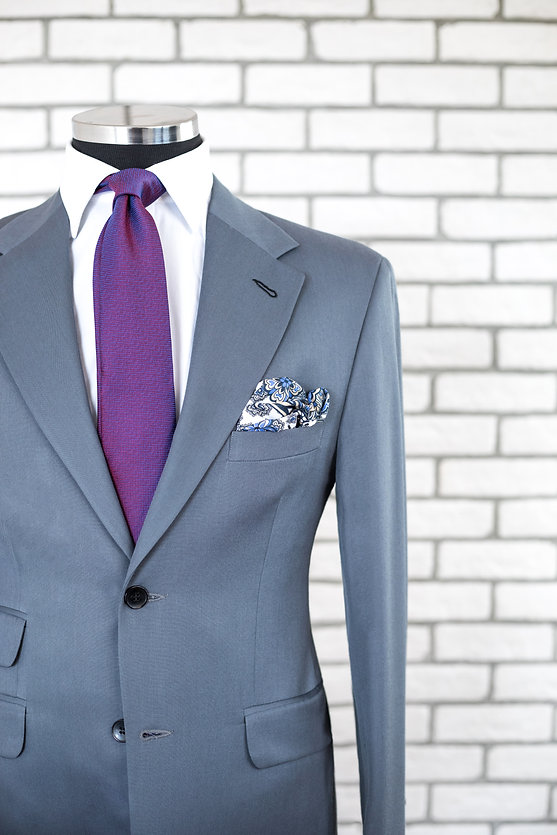 Expensive custom tailored suit on male m