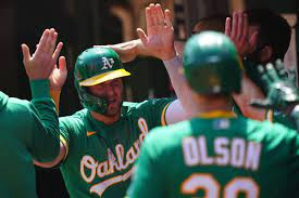 A's best Twins 13-12 in extras to win 11th straight