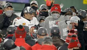 Brady throws 3 interceptions, but Buccaneers hang on to host Super Bowl
