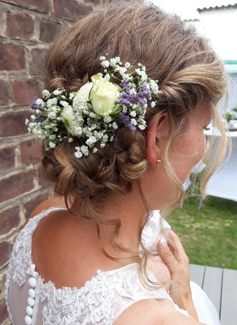 Loose and playful hairstyles for the bride.