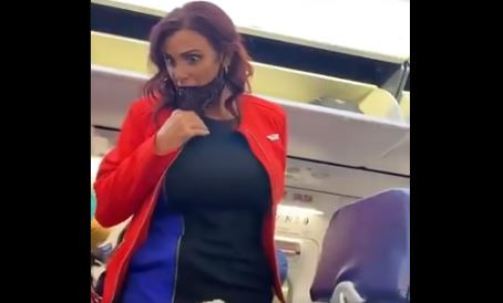 VIDEO: Woman Who Won't Leave a Flight Lets Out an Insane Scream