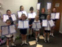 Goggin-Carroll Irish dancers proudly displaying Grade Exam certificates