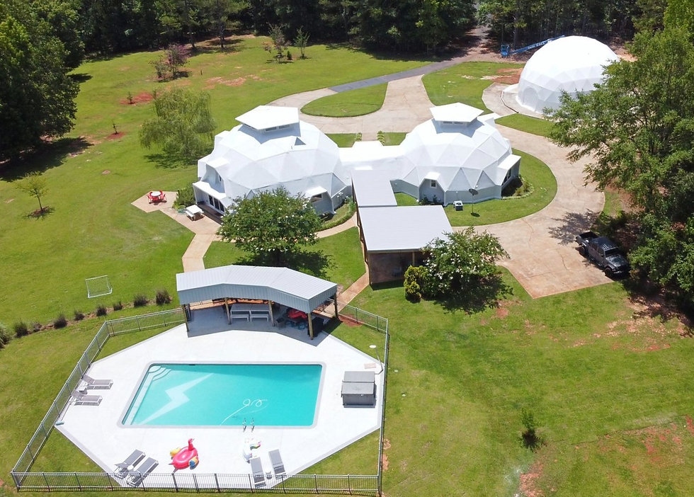 Aerial done picture of the property. Pool and Jacuzzi, El lounge, Dome house and Event dome