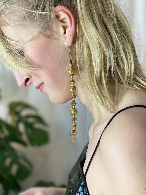 Lange gouden oorbellen