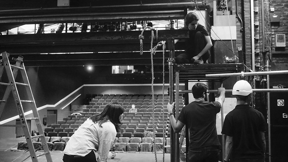 Theatre technicians at work putting up scaffolding in the ADC Theatre, Cambridge