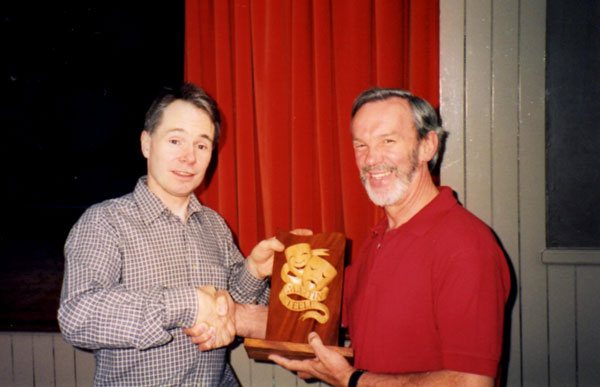 Andrew Taylor, left, receiving the Martin Steele Award in 1998 from then chair David Brown, right