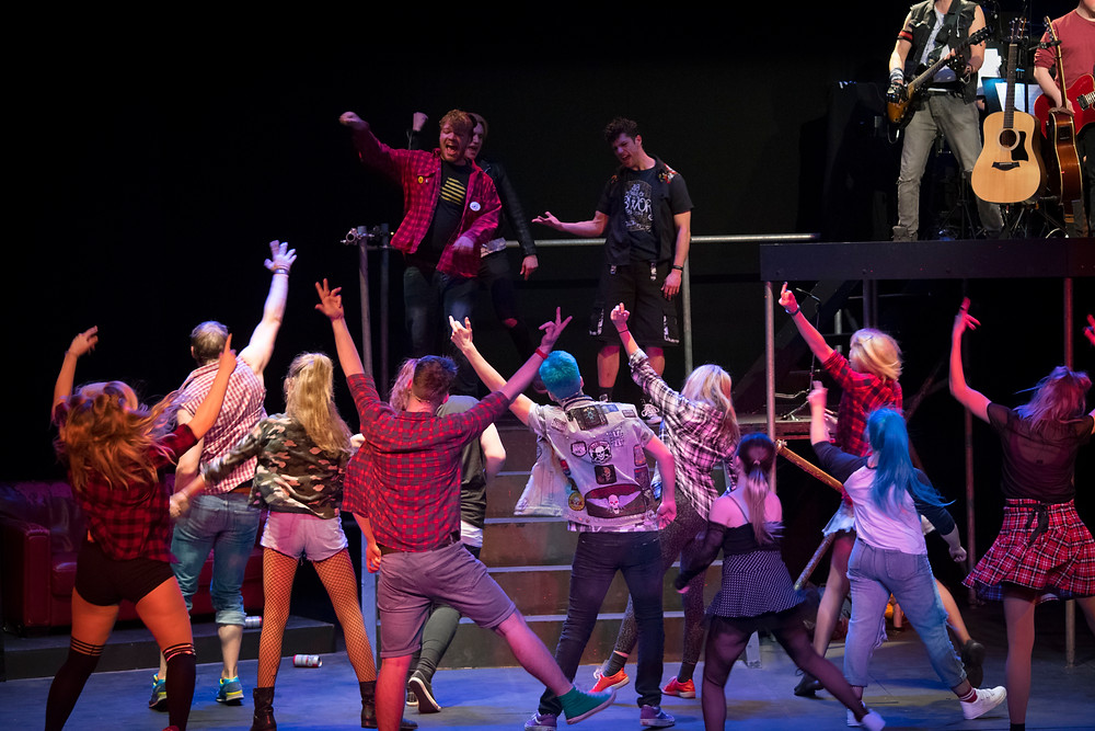 Cast of American Idiot dancing energetically