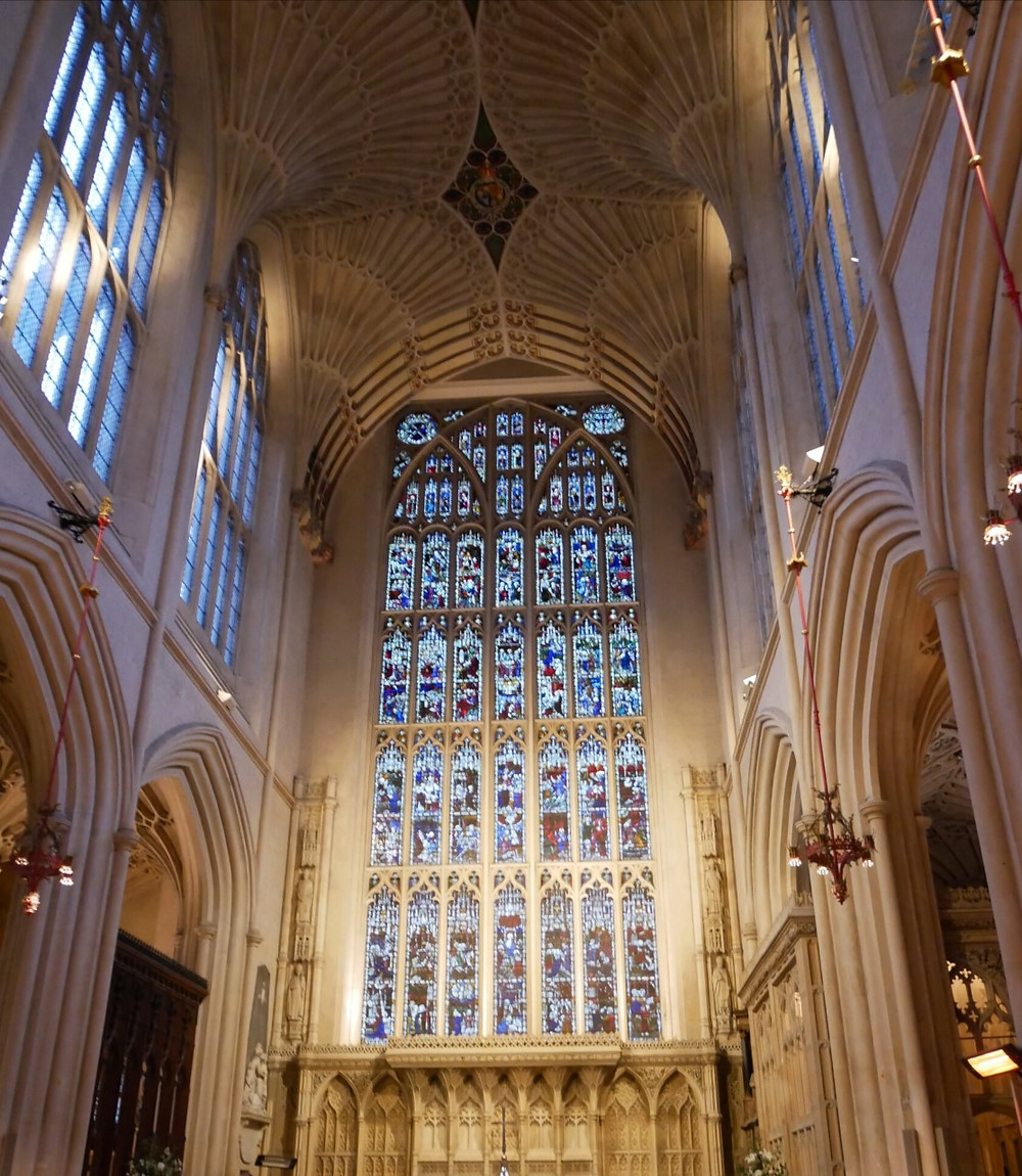 The stunning interior of Bath Abbey looking towards the stained glass