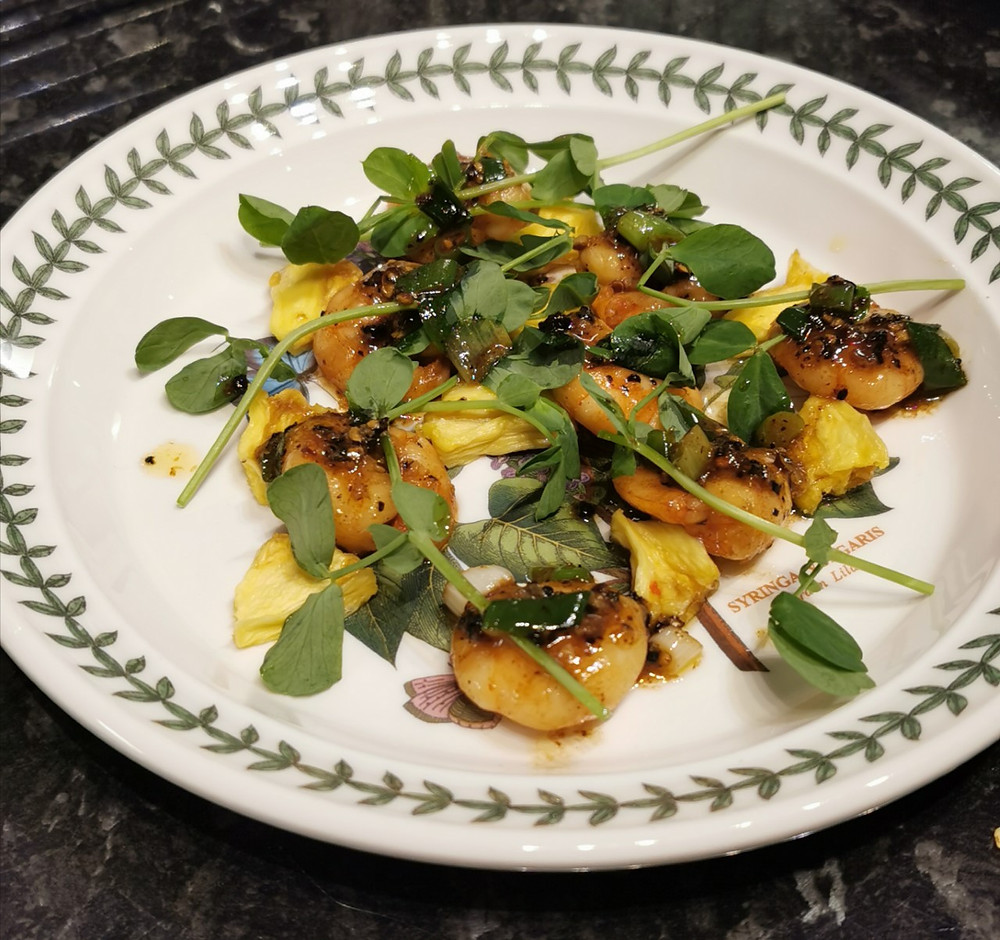Black pepper prawns with dehydrated pineapple and pea shoots
