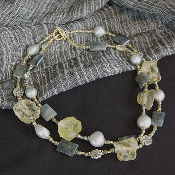 Double strands of lemon yellow quartz, faceted labradorite, gray baroque pearls and silver flowers compose a classic necklace