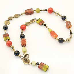 Venetian glass rectangles, orange carnelian nuggets, green faceted opal cubes, black onyx necklace