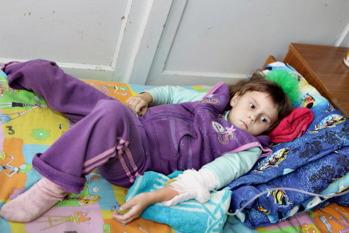 Sick girl in the Children's wing of Ushachi hospital