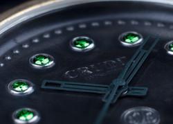 Crude-gypsetter-gold-dial-green diamond.