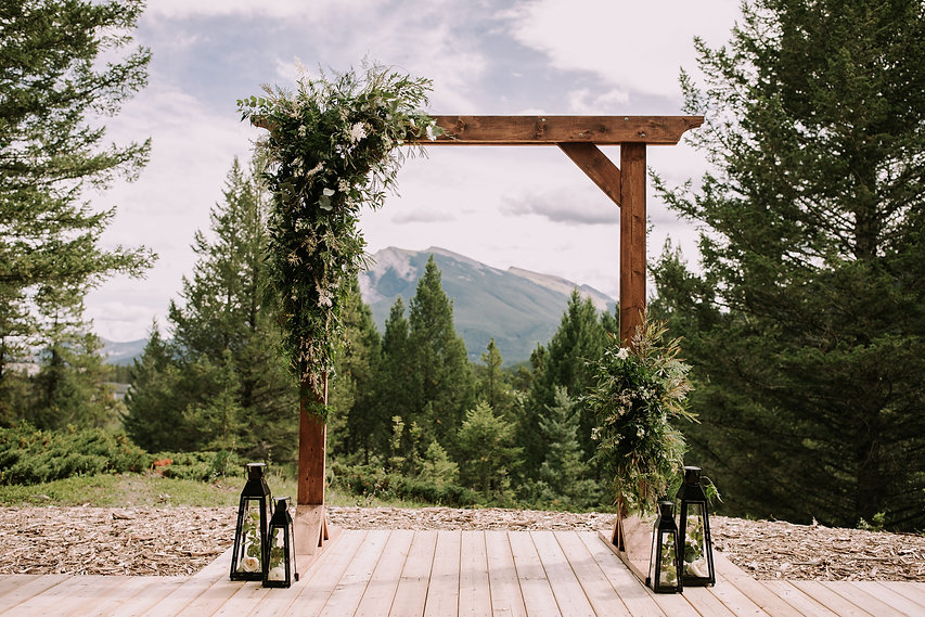 rustic arch and lanterns rented for a wedding ceremony in the mountains