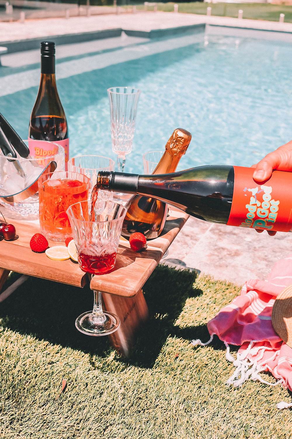 Wine picnic by the pool with pinot noir