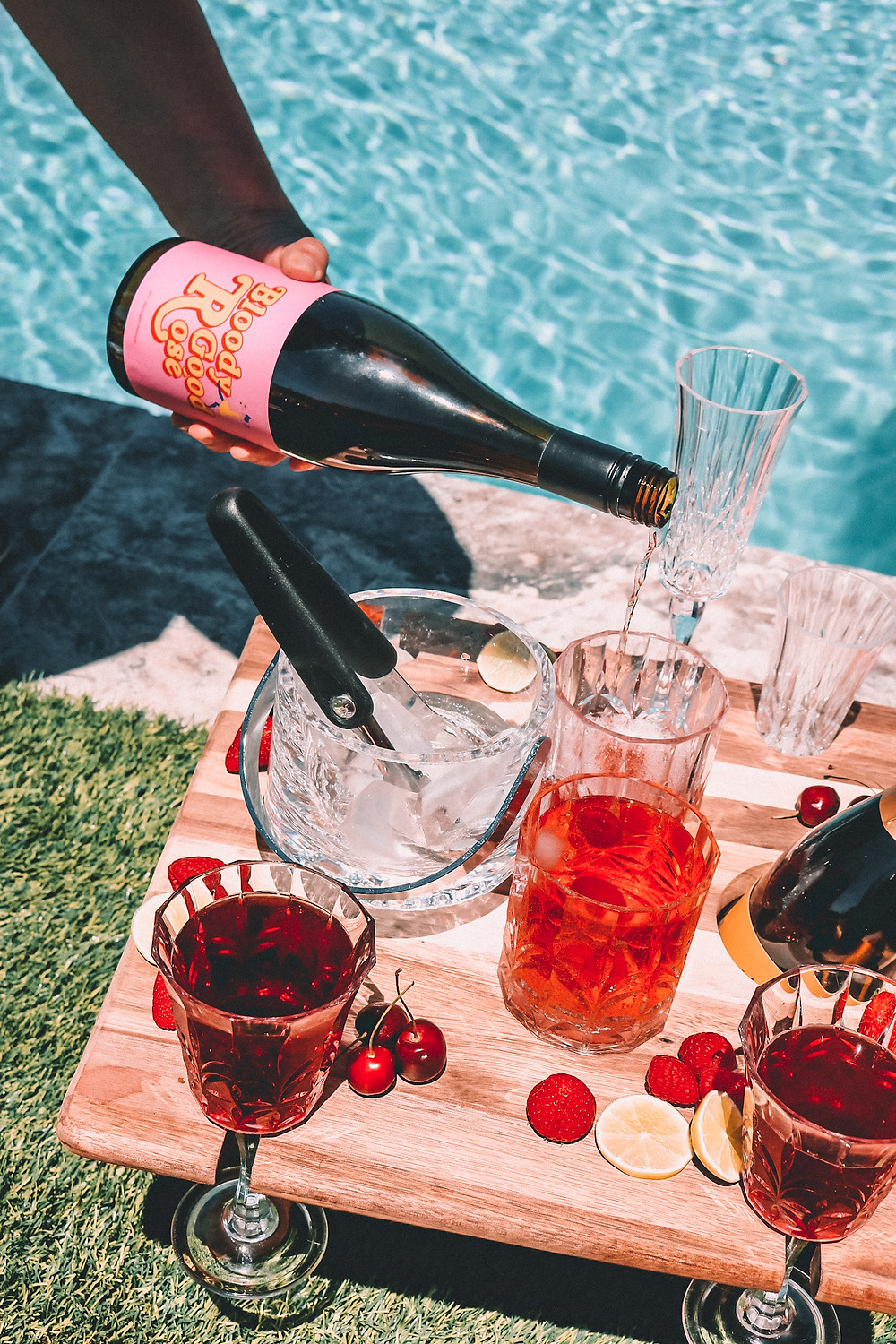 Rosé by the pool with a picnic