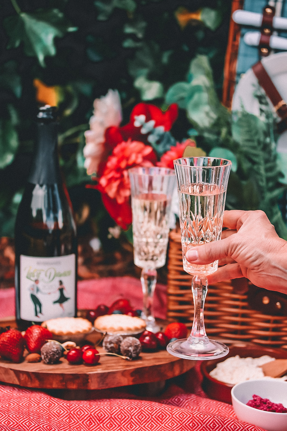 A glass of champagne at a romantic picnic