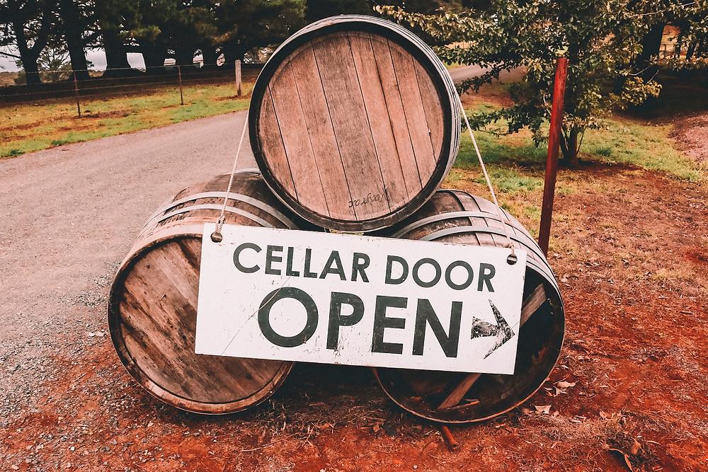 Cellar door sign on wine barrels