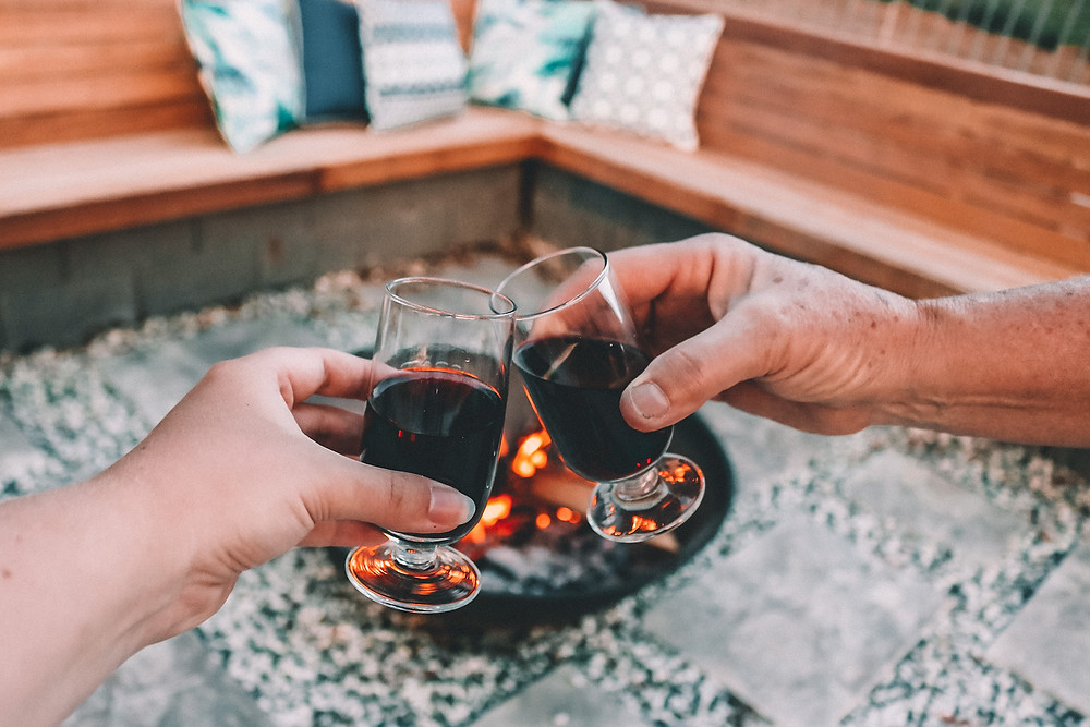 Two glasses of port by the fire