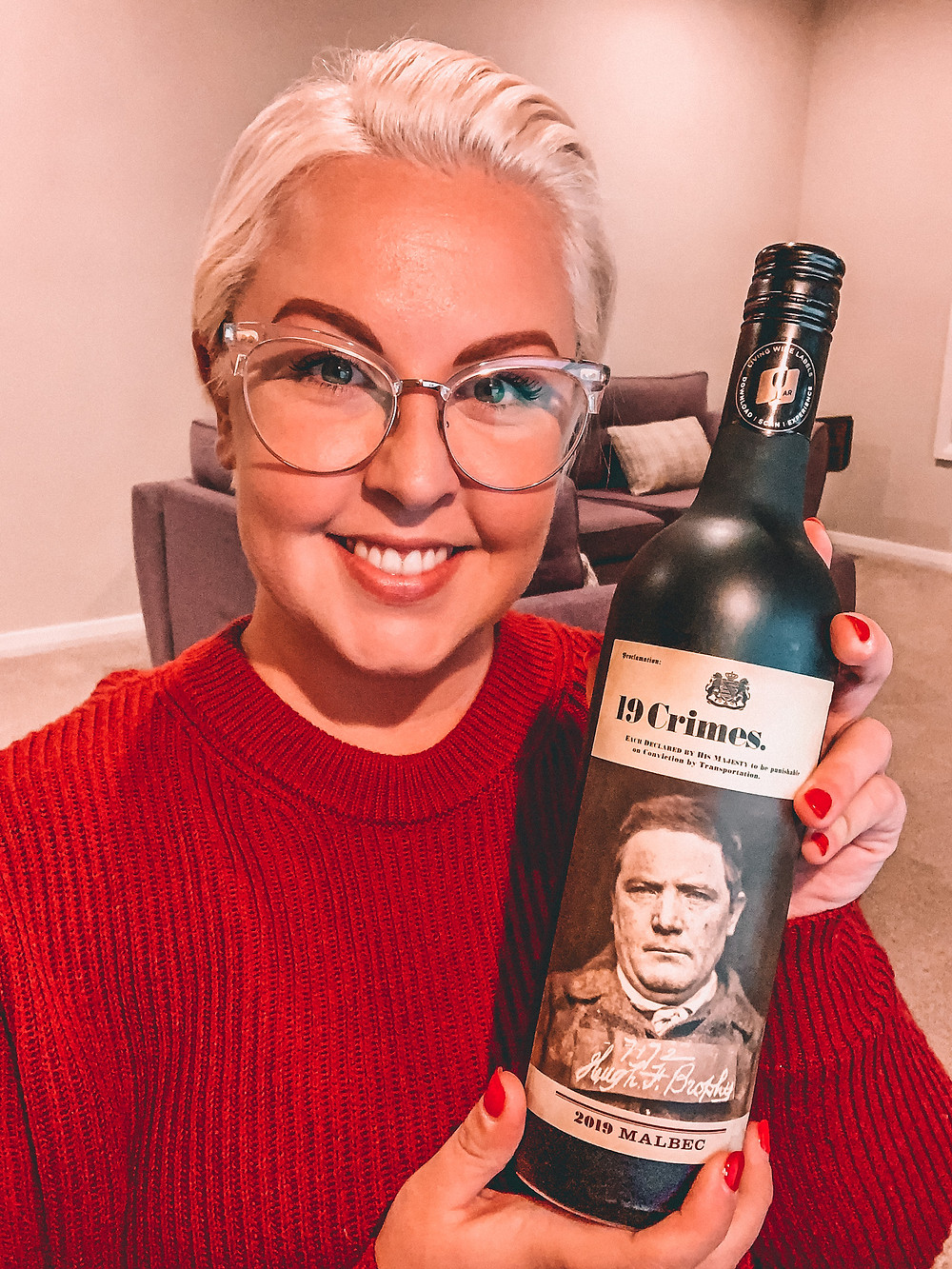 Wine influencer holding red wine bottle