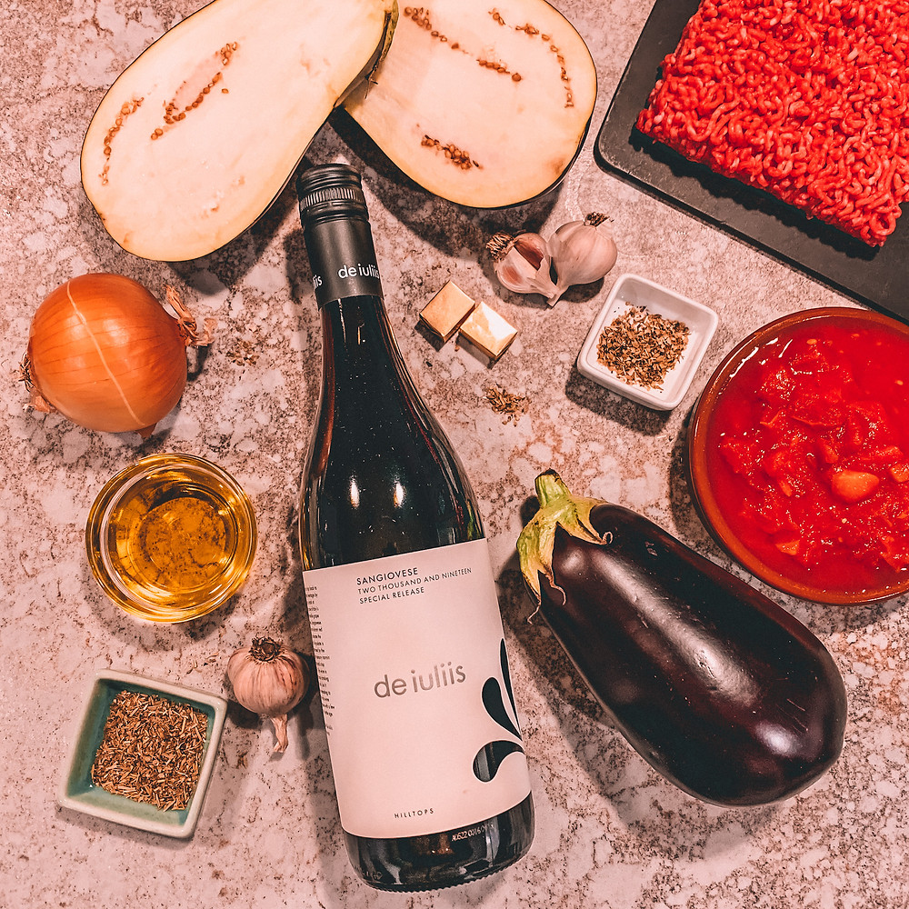 Flatlay of wine and recipe ingredients