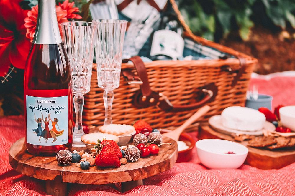 Sparkling rosé at a romantic picnic