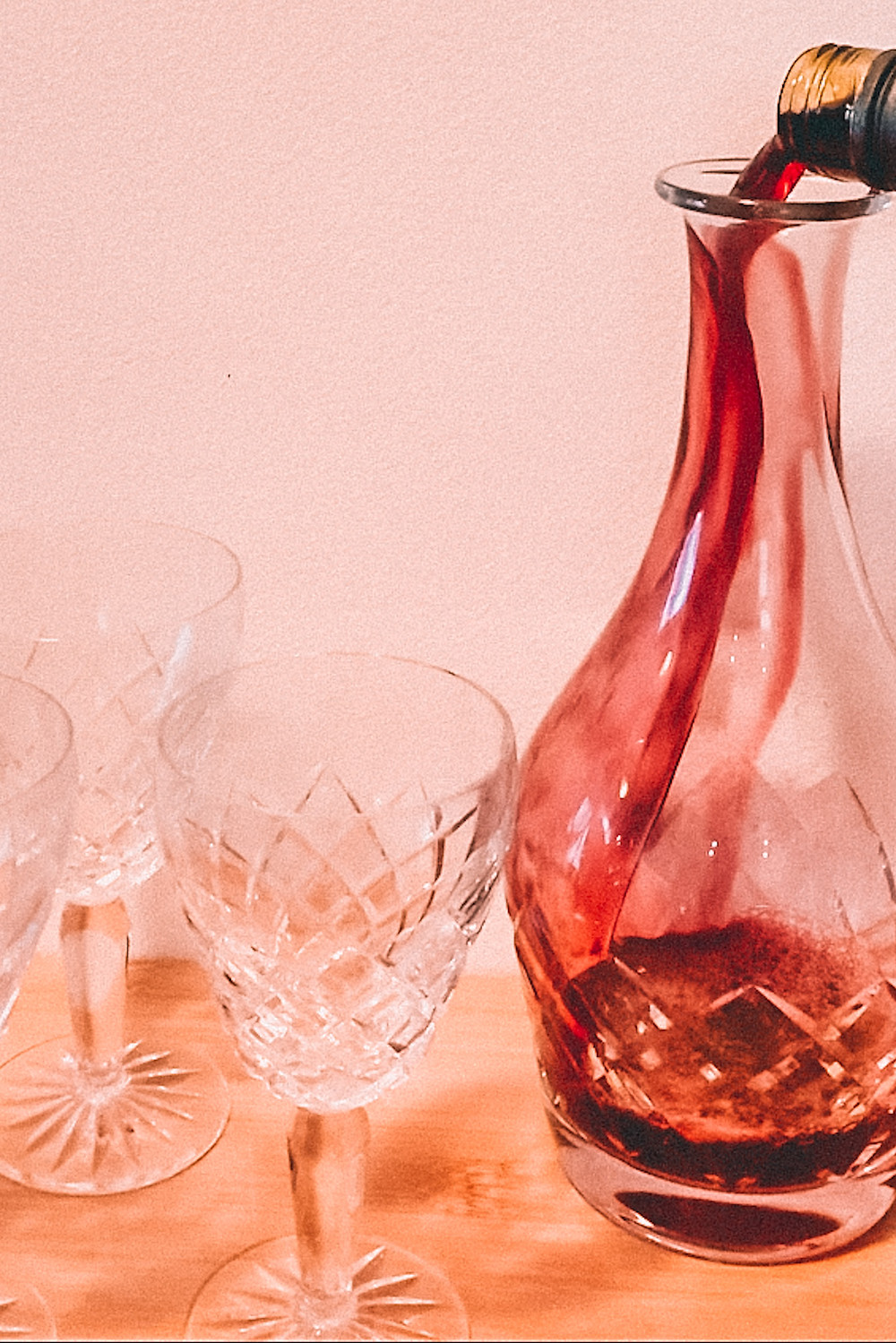 Decanting wine into a crystal decanter
