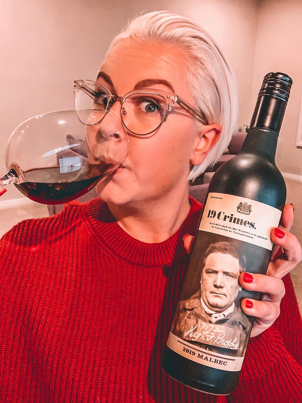 Wine influencer drinking red wine