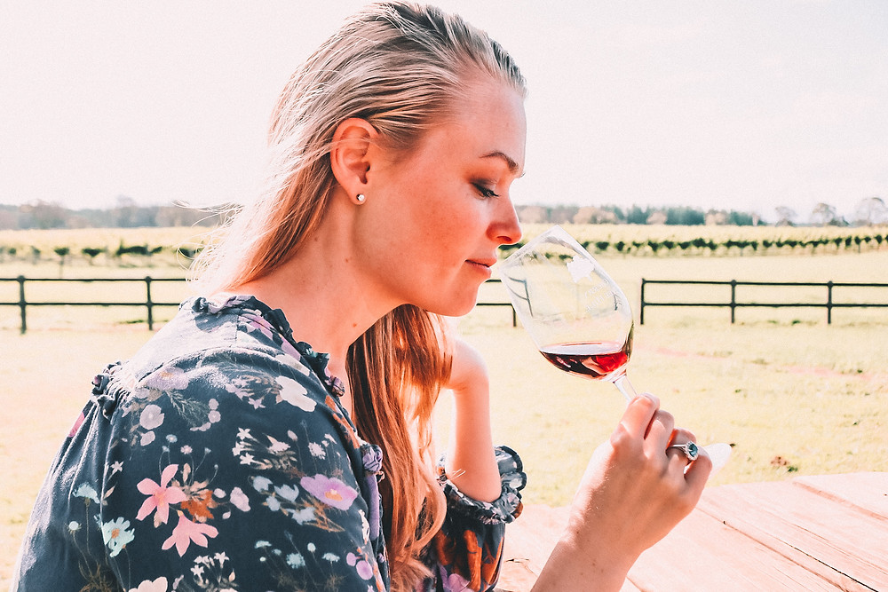 A woman sniffing wine