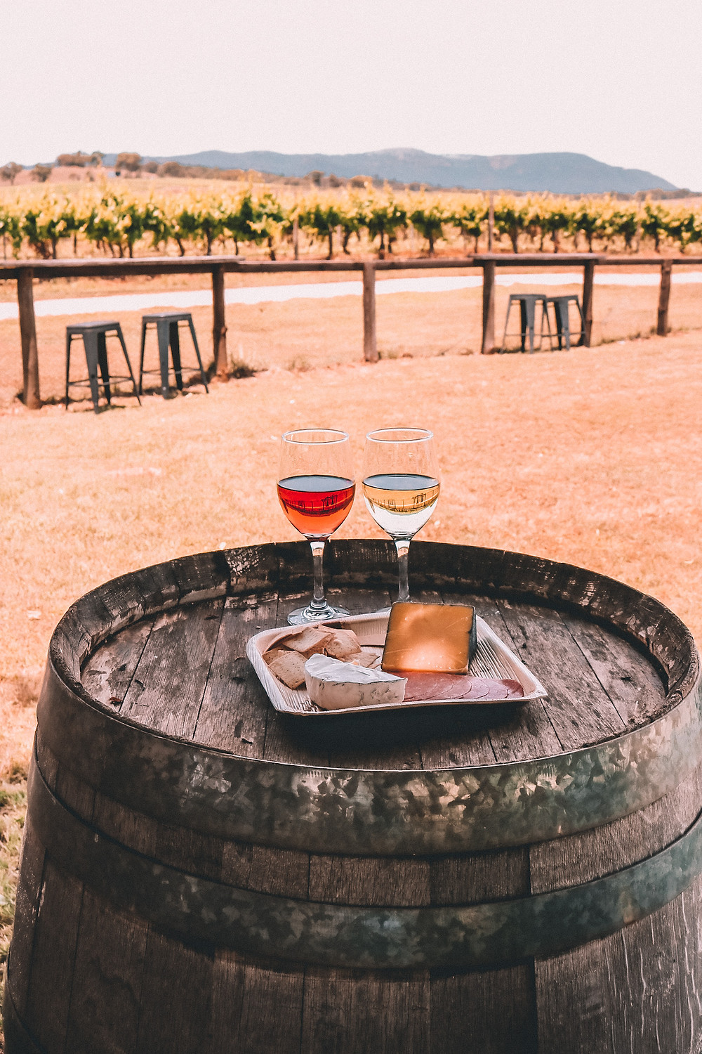 Wine and cheese plate on a wine barrel