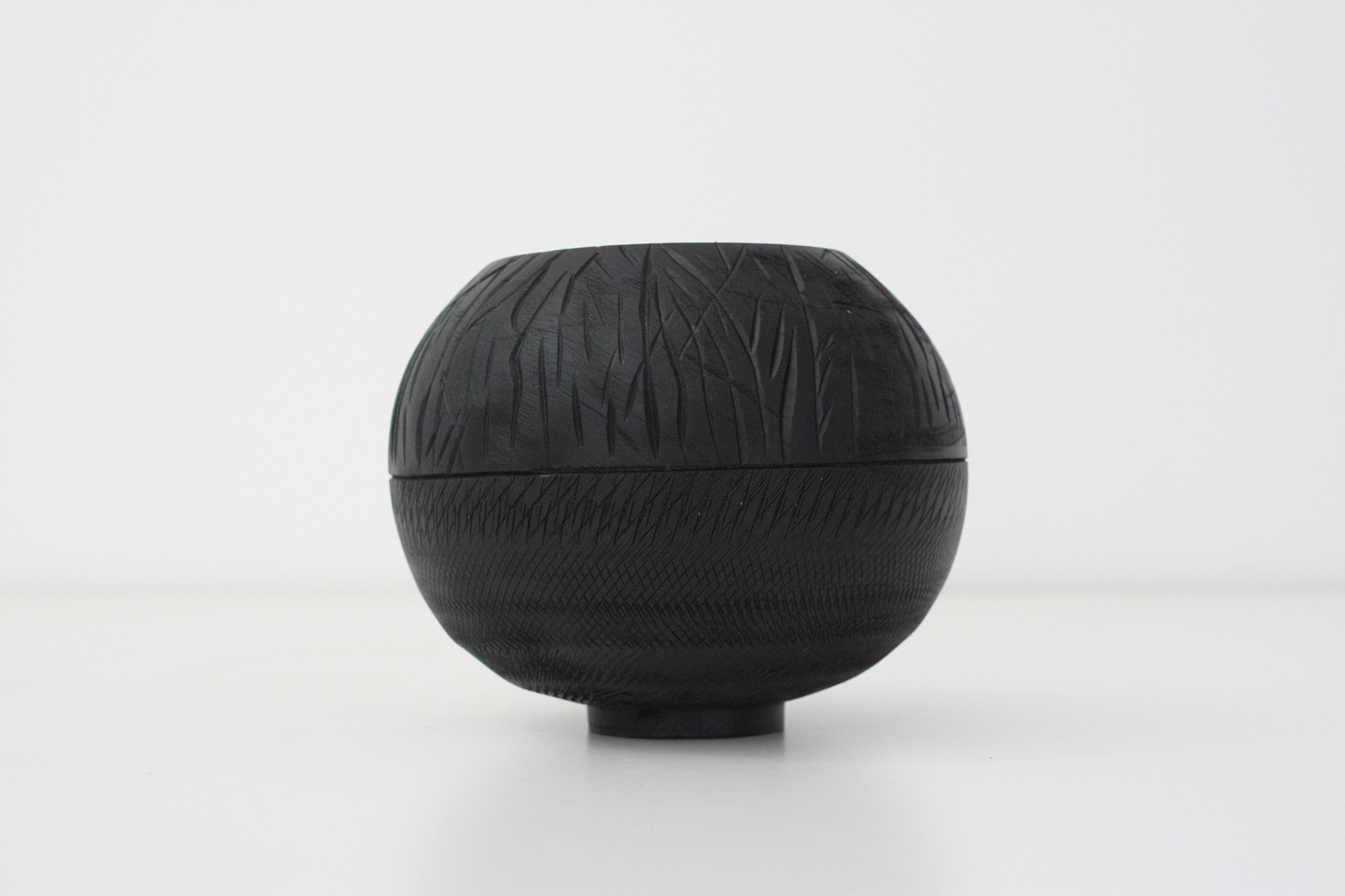 Textured black sphere