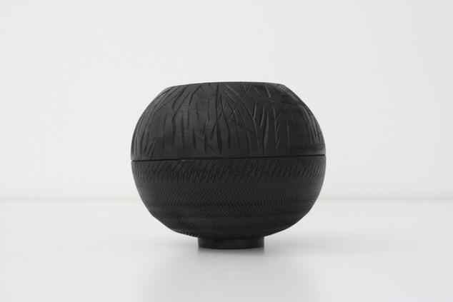 Textured black sphere