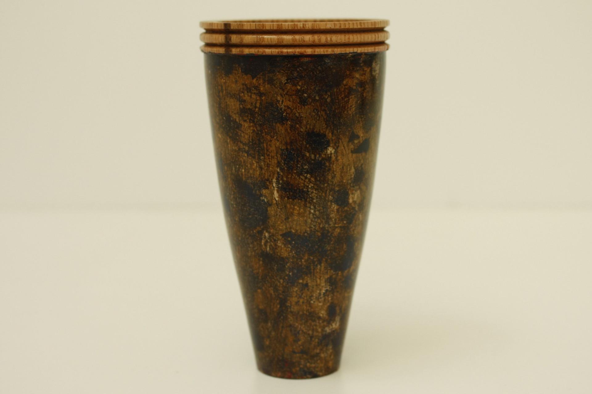 Patinated oak vase