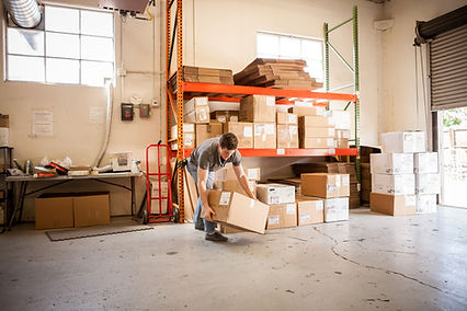 worker lifting storage boxes