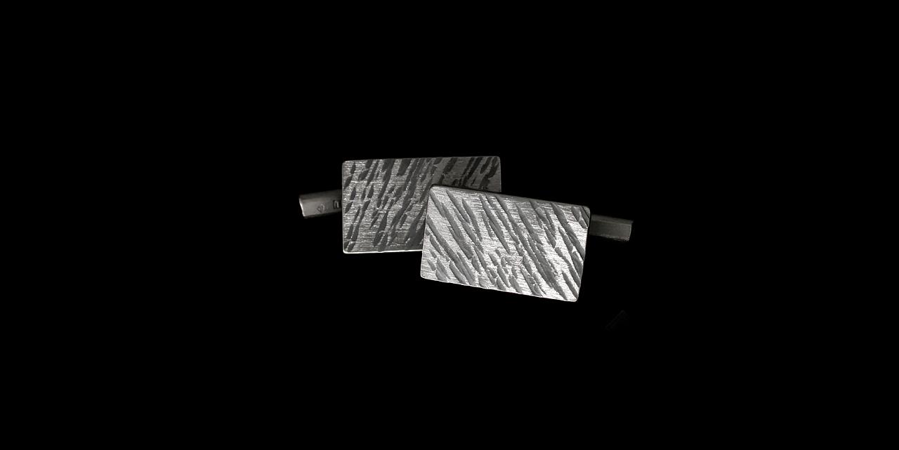 Titaaniset kalvosinnapit
