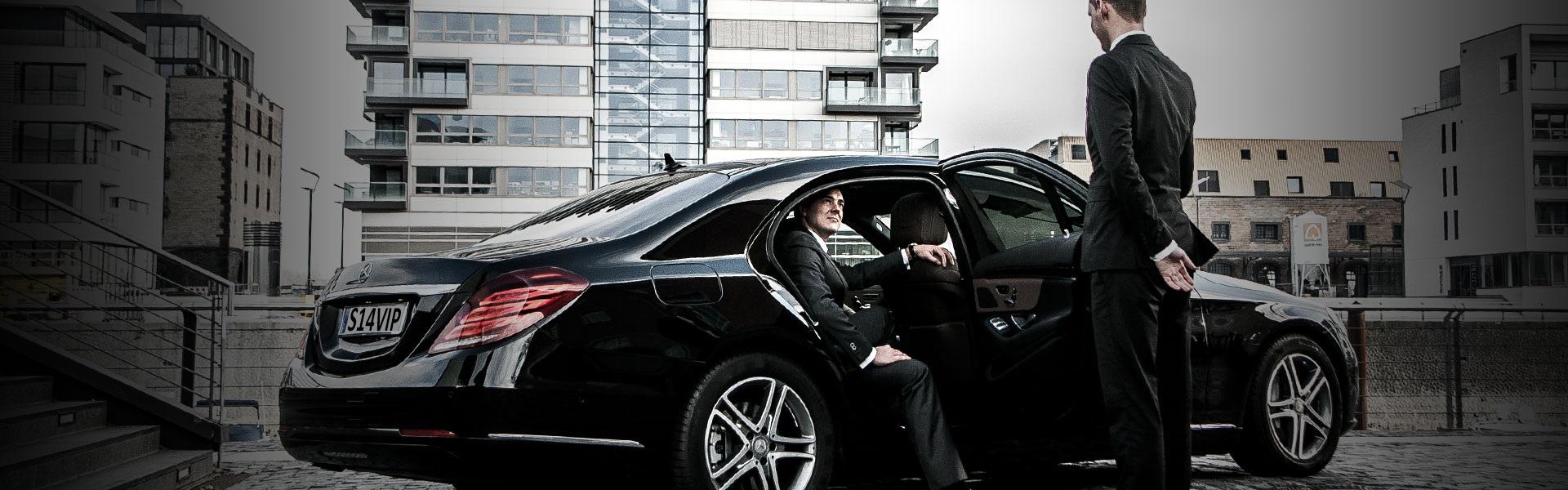 bl-slider-chauffeur-opening-limousine-door-for-businessman2-1