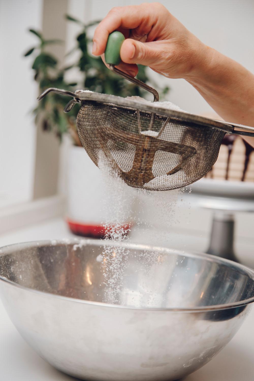 whisking flour to make a roux