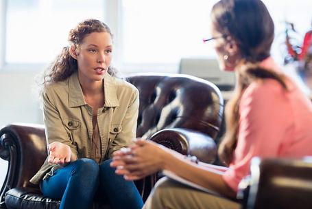 shutterstock_572935282-two-women-talking