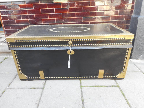 Brass bound covered wooden trunk