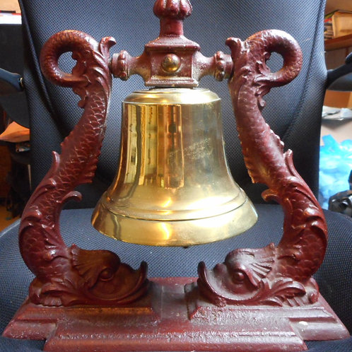 Brass bell with dolphin surround
