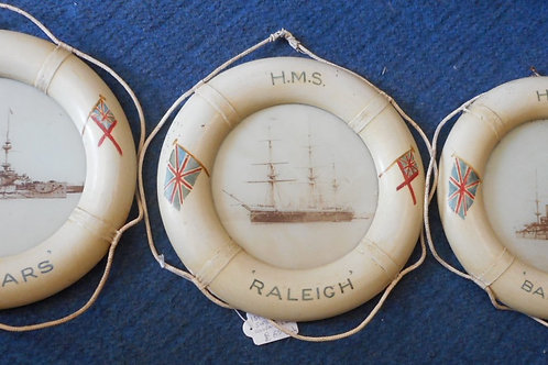Painted lifebelts with HMS ships