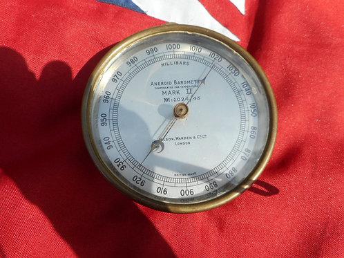 Brass aneroid barometer by Wilson Warden