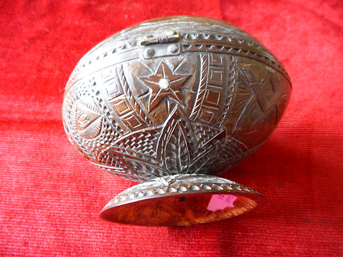 Beautifully carved coconut shell